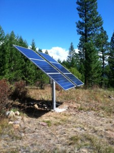 off grid, pole-mounted array, part of a grid-tied, battery-backed solar PV system in Montana.